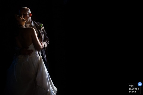 Murcia bride and groom dance and kiss in the dark at the wedding
