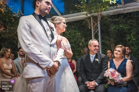 Ro de Janeiro, Brazil bride and groom smile and get emotional at the wedding ceremony