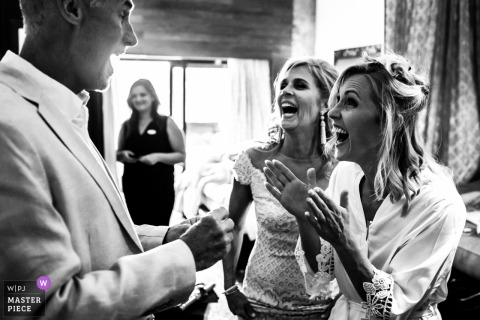 Cabo san Lucas, Mexico bride laughs with her mother and father before the wedding ceremony
