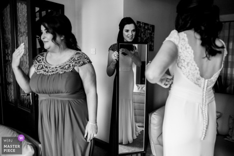 Dublin, Ireland bride looks at herself in the mirror while in her dress before the wedding ceremony