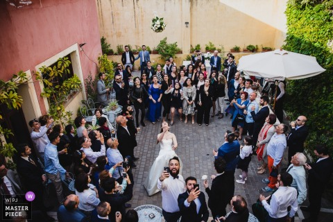 Guests get ready to catch the bouquet at the wedding reception in Sardinia