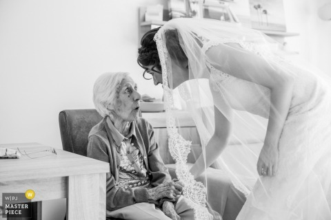 Netherlands bride in her dress talks with elderly woman before the wedding ceremony