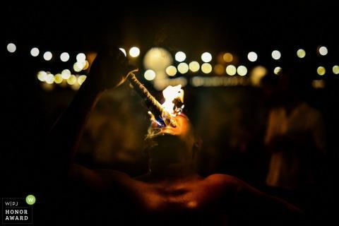 IF Villa, Talpe, Sri Lanka wedding photography - fire eating man provides entertainment at the reception