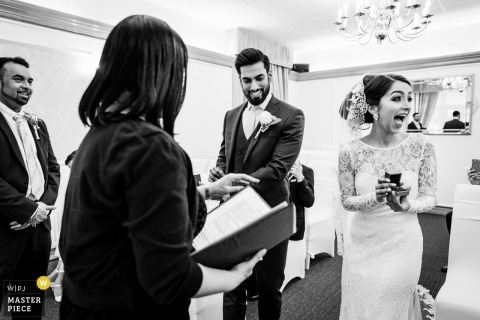 London, UK bride gets excited when she sees the ring during the  wedding ceremony