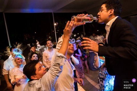 Mexico City groom partying with groomsmen at the reception