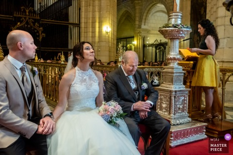 Murcia bride holds the grooms hand during the church wedding ceremony