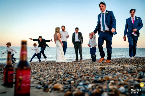 Thorpeness, UK bridal party enjoying the beach at the wedding