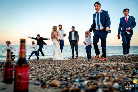 Thorpeness, UK bridal party enjoying the beach at the wedding