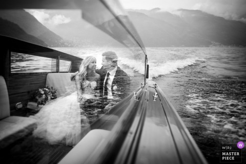 Lake Como, Relais Villa Vittoria bride and groom smile at each other while in a boat