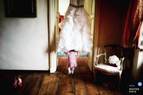 Villa Soleil, Colleretto girl walking underneath the brides dress