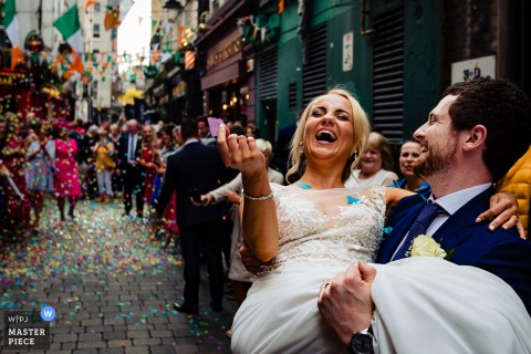 Dublin groom holds bride as they smile after the wedding