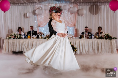 Romania bride and groom dance at the wedding reception