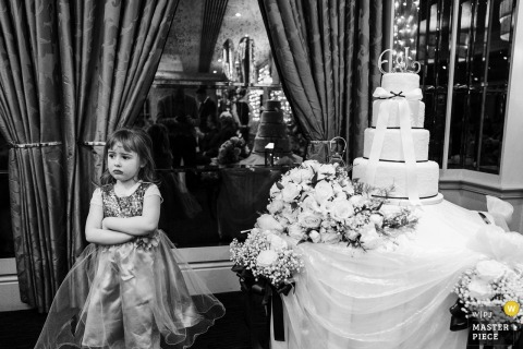 Cheshire, England girl stands next to the wedding cake