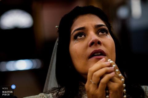 Cortegaça, Portugal bride praying at the wedding ceremony