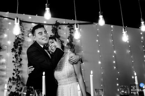 Viana do Castelo, Portugal bride and groom hug and smile at the wedding reception
