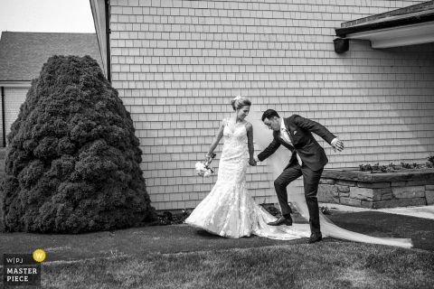 Cape Cod, Massachusetts groom accidentally steps on the brides dress outside after the wedding