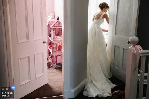 Edinburgh bride getting ready for the wedding in her dress