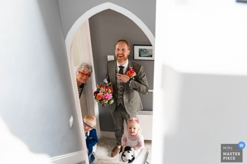Netherlands groom with kids and mother before the wedding ceremony