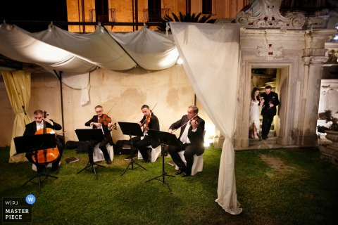 Calabria band plays music as the bride and groom enter the wedding reception