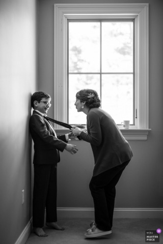 Woman talks to boy in tux before the wedding at the Great Oak Manor, Chestertown