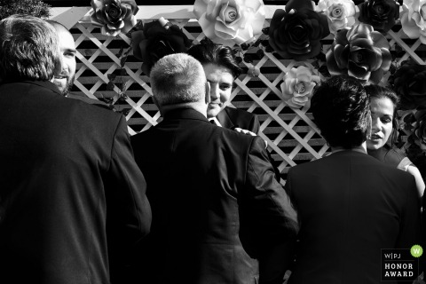 bucharest outdoor wedding ceremony with hugging guests and bridal party members