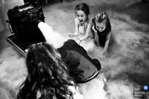 Bucharest kids play with the fog machine at the wedding reception