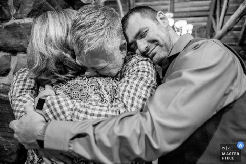 Evergreen, Colorado groom hugs guests after the wedding ceremony