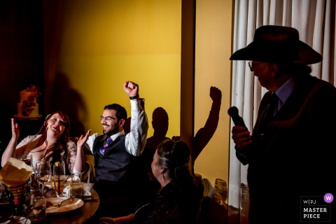Chicago, Illinois bride and groom celebrate at the wedding reception