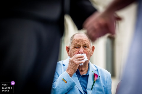 Chicago, Illinois father gets emotional as bride and groom hold hands at wedding ceremony