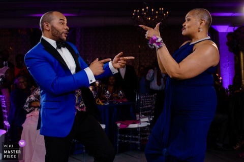Chicago wedding guests point at each other while dancing at the reception