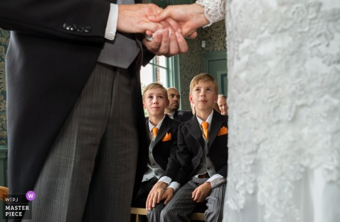 Amsterdam boys watch as the bride and groom hold hands during the wedding ceremony