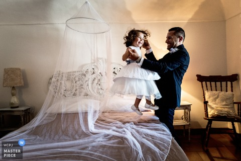 Antico Casale Borgofranco groom plays with flower girl before the wedding ceremony