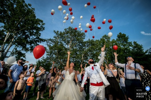 Villa Soleil, Colleretto bride and groom release balloons at the reception
