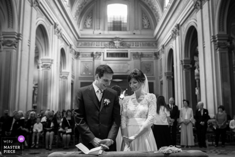 Rome bride and groom smile at each other during the wedding ceremony