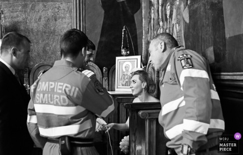 Bucuresti bride talks with fire department rescue paramedics at the wedding