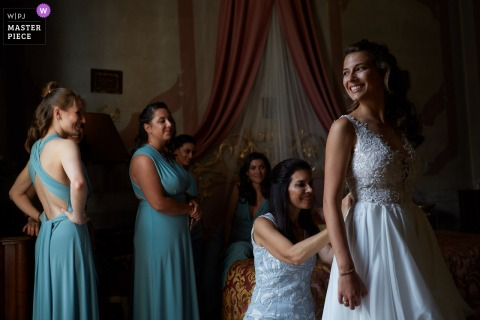 Villa Molin, Italy bridesmaids helping the bride with her dress before the wedding