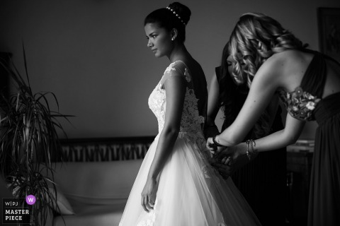 Venice, Italy bridesmaid helping the bride get ready for the wedding ceremony