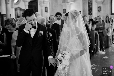 Padova, Italy groom gets emotional next to the bride during the wedding ceremony