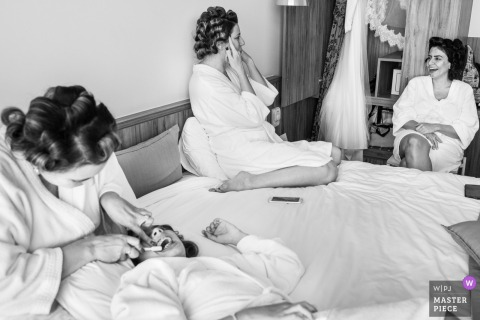 Rio de Janeiro, Brazil bride and bridesmaids talking while getting ready before the wedding