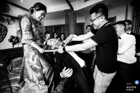 China bridal party having fun playing games at the wedding