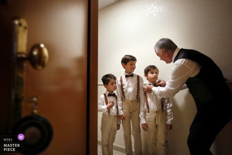 Calabria groom helps some boys with their bow ties before the wedding
