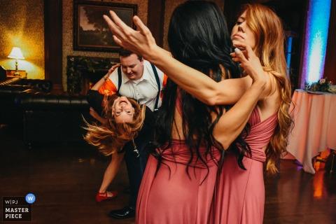 San Francisco bridal party dancing and dipping at the wedding reception