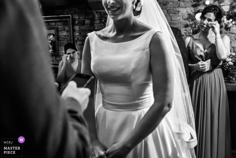 São Paulo bridesmaid gets emotional as bride smiles during the wedding ceremony