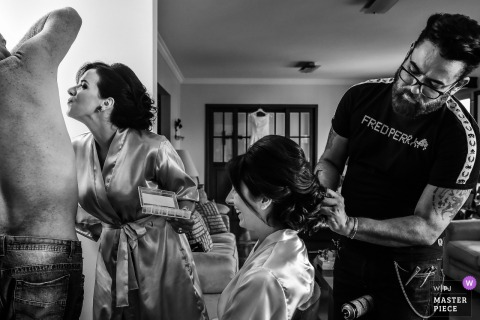 São Paulo bride smiles as she gets her hair done before the wedding ceremony