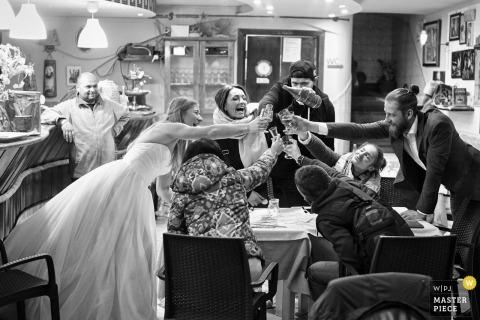 Italy, Naples bridal party enjoying drinks at the wedding reception