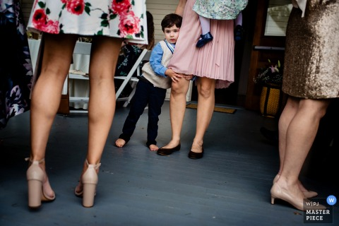 Grand Isle, Vermont boy holds onto mother at the wedding