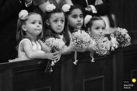 Four flower girls have front row seats in this image from a Ciudad de Victoria, Mexico wedding.