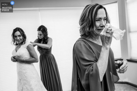 Brides mother starts to cry as she sees her in the wedding dress at Lake Tahoe
