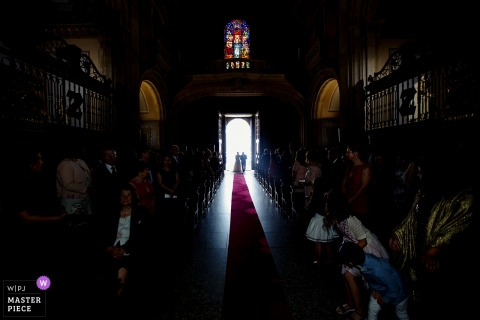 Picture of the bride and her father entering the church for the wedding ceremony in Braga, Portugal
