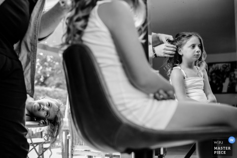 Houthalen bride and flower girl getting their hair done before the wedding ceremony